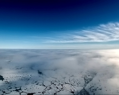 Clouds in different layers in the Arctic. The high clouds on the horizon are coming from far away, and means a shift in the weather, while low clouds are those that will be studied in the project. Picture taken during a previous project, ASCOS, with a camera attached under a tethered balloon.